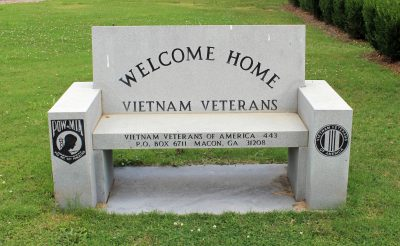 Veterans Memorial Bench in park across from City H...